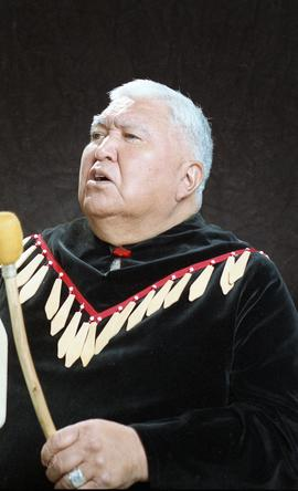 Bob George, First Nations elder, in First Nations garment playing an instrument [35 of 36 photogr...