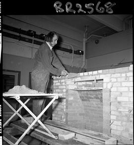 B.C. Vocational School image of a Bricklaying student building a brick fireplace in the shop
