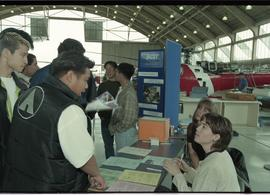 Aviation Open House 1996; crowd at booth [2 of 2 photographs]