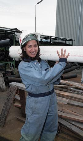 BCIT women in trades; plumbing, students in uniforms and hard hats carrying piping material [10 o...