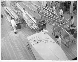 Students working in a boat building workshop; Photo by the Division of Visual Education, Dept. of...