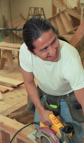 First Nations student wearing a tool belt and using a woodworking tool [9 of 13 photographs]