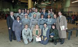 BCIT women in trades; steel fabrication, group shot of students in uniforms, BCIT staff members a...