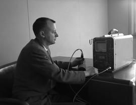 Instrumentation, 1964; man sitting at a desk using an ultrasonic flaw detector [3 of 4]