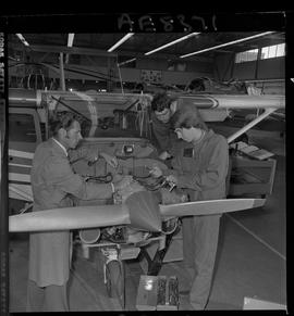 BC Vocational School; Aeronautics students with an instructor working on a small propeller aircra...