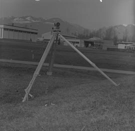 Survey, 1971; a level on a tripod on a hill [1 of 4]