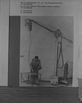 Welding, 1967; picture from a book of a man using a semi-automatic CO2-shielded welding machine ;...
