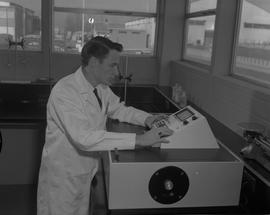 Food Processing Technology, 1966; man wearing a lab coat adjusting settings on food processing eq...