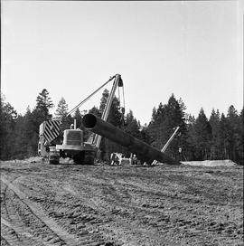 Heavy duty equipment operator, Nanaimo ; a pipelayer moving a large pipe