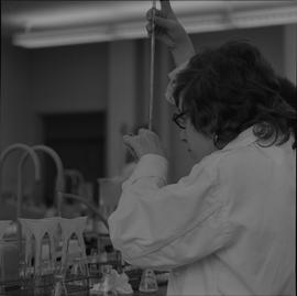 Medical laboratory technology, 1968; student working in a medical lab [2 of 3]