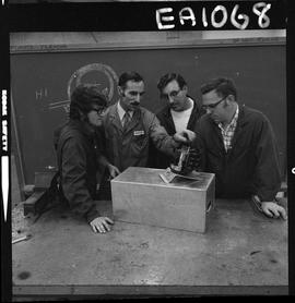 BC Vocational School image of an instructor and three students in the Appliance Servicing program...