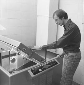 BCVS Graphic arts ; man using a Nuarc plate maker [1 of 2]