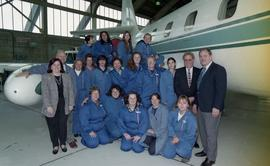 BCIT women in trades; aviation, group shot of female students, staff and instructors wearing avia...