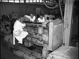 BCVS Heavy duty mechanic program ; instructor and two students looking at a large engine ; studen...