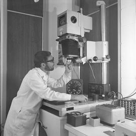 BCVS Graphic arts ; man using a Durst Laborator photo enlarger