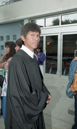 First Nations graduate in graduation robe