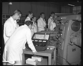 Mechanical technology, 1968; men in lab coats using a Weston Model 639 Industrial Analyzer on a l...