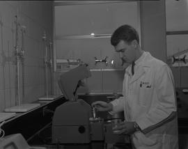 Food Processing Technology, 1966; man wearing a lab coat adding samples to food processing test e...