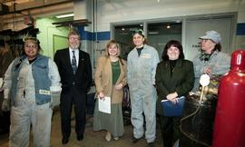 BCIT women in trades; steel fabrication, BCIT staff members and VIPs standing beside a few studen...