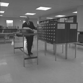 BCIT Burnaby campus library ; a man using the subject card catalogue