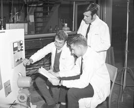 BCIT Programs Gas & Oil Technology ; three men sitting in front of equipment and looking at a...