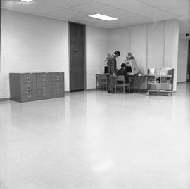 BCIT Burnaby campus library ; two men looking at a microfilm reader