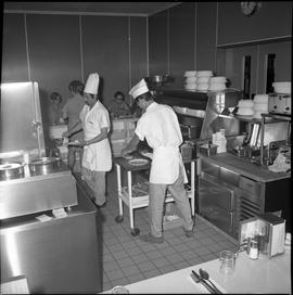 BC Vocational School Food Training Centre ; two students preparing plates of food for the cafeter...