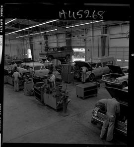 B.C. Vocational School image of the Automotive Mechanics program shop with students working on ve...
