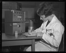 Medical isotope option, Health technology, 1968; a student writing notes ; a compact analyzer and...