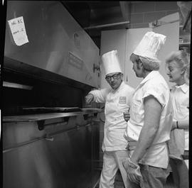 BC Vocational School Cook Training Course ; instructor (Arthur L. Brown) in front of the oven tal...