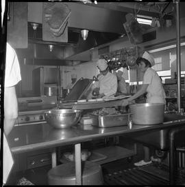 BC Vocational School Cook Training Course ; student scooping soup into a bowl ; student pushing c...