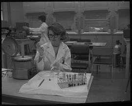 Medical isotope option, Health technology, 1968; a student measuring liquid in a lab flask ; medi...