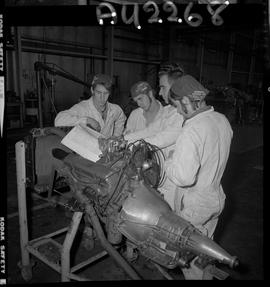 BC Vocational School image of an Instructor and Automotive program students working on an engine ...