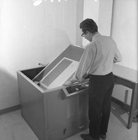 BCVS Graphic arts ; a man adjusting a Nuarc plate maker [2 of 2]