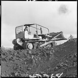 Heavy duty equipment operator, Nanaimo ; man operating a bulldozer on a hill of dirt