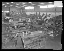 British Columbia Vocational School image of Aeronautics students working on aircraft engines insi...