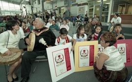 "BCIT open house '98, First Nations woman, elder, and youths with posters that read ""First Na..."