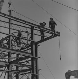 Structural steel, 1971; workers standing at the top of a steel structure [1 of 2]