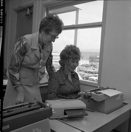 BC Vocational School Commercial Program; student using a typewriter to transcribe recorded inform...
