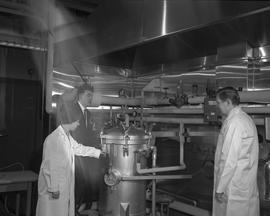 Food Processing Technology, 1966; instructor and two students using food processing equipment - f...