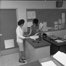 BC Vocational School Commercial Program; instructor and student looking at paperwork [1 of 2]