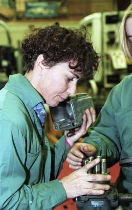 BCIT women in trades; heavy duty, students in uniforms using mechanical tools and equipment [7 of...