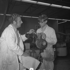 Small engine repair, 1971, Prince George; instructor talking to a student working on an engine