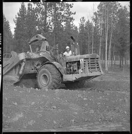 Heavy duty equipment operator, Nanaimo ; man working on an Allis-Chalmers 260 scraper