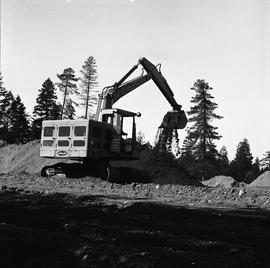 Heavy duty equipment operator, Nanaimo ; an excavator scooping dirt