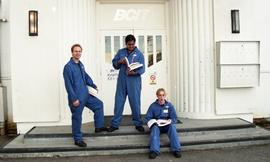 Aviation, students in uniforms holding books while standing outside a BCIT building [4 of 10 phot...