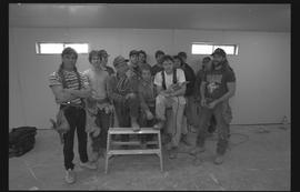 Students holding power tools and posing for a group shot during gym construction [8 of 8 photogra...