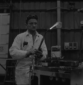 Welding, 1968; man turning on a welding torch [1 of 2]