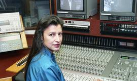 Aboriginal woman sitting beside broadcasting equipment [17 of 22 photographs]