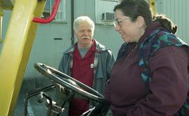 BCIT women in trades; forklift training, instructor beside a student driving a forklift [5 of 8 p...